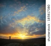 men  who welcome sunrise with... | Shutterstock . vector #185817380