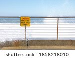 Sea Wall With Caution Sign...