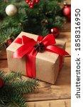 Christmas Gift Box On Wooden...