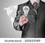 business man touching light of... | Shutterstock . vector #185835989