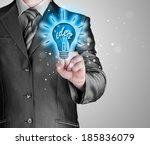 business man touching light of... | Shutterstock . vector #185836079