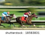 Stock photo two racing horses competing with each other with motion blur to accent speed 18583831