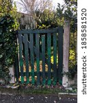 Green And Old Wooden Gate