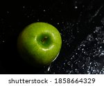 One Green Apple On Wet Black...
