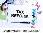 a notepad with text tax reform... | Shutterstock . vector #1858685830