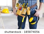 Part of construction worker with tools belt  - stock photo