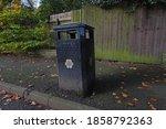 A Roadside Rubbish Bin With...