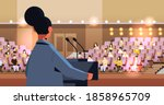rear view female doctor giving... | Shutterstock .eps vector #1858965709