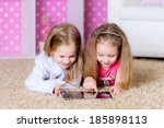 sisters using a tablet computer    Shutterstock . vector #185898113