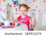 little girl draws sitting at...   Shutterstock . vector #185911274