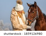 Woman With Young Horse At...