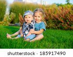 happy children on green grass... | Shutterstock . vector #185917490