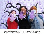 Three Women With Their Hands...