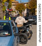 Small photo of Orvinio, Italy - October 31, 2020, Masked and unmasked traveling bikers who stop to eat in Italian Borgo Orvinio during second wave of coronavirus (Covid19), non-observance of social distance in Italy