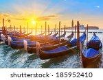 Venetian gondolas at sunrise, Venice, Italy - stock photo