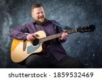 Mature Musician Plays Acoustic...