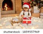 Little Girl Opening Christmas...