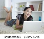 mid adult woman using laptop on ... | Shutterstock . vector #185974646