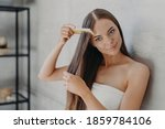 Young Brunette Woman Brushes...