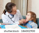 pediatrician doctor looks mouth