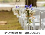 Flowers Hanging In Mason Jar A...