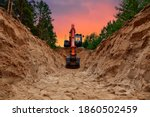 Excavator Dig Trench At Forest...