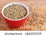 dry green lentils in red bowl...   Shutterstock . vector #186055529