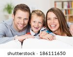 Laughing Happy Young Family...