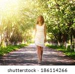 Girl Walking In The Park. Spring