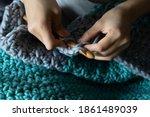 Woman's Hands Crocheting...
