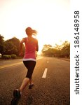 young fitness woman running at... | Shutterstock . vector #186148958