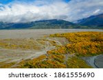 Knik River Valley Through The Chugach Mountains With Thick White Clouds Covering The Peaks