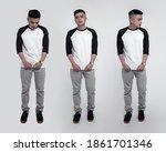 man posing wearing black white... | Shutterstock . vector #1861701346