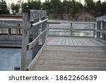Wooden Dock Floating On Ice...