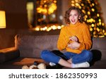 Happy Woman In Knitted Sweater...