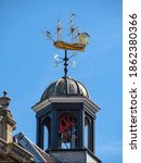 Small photo of ROCHESTER, KENT, UK - 09.13.2019: The cupola and weather vane in the form of a fully rigged 18th-century warship above Rochester Guildhall Museum