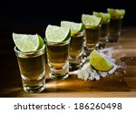 tequila   lime and salt on... | Shutterstock . vector #186260498