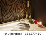 Small photo of Romantic setting. Candle lights and rose agh the bathroom.