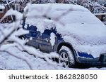 Snow Covered Car In The Yard....