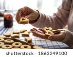 Woman Making Linzer Biscuit On...