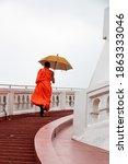 Buddhist Monk Walking Up The...