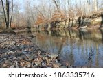 Rocky River Bank In A Forest...