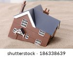 a house sinking in sand ... | Shutterstock . vector #186338639