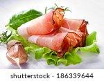 sliced prosciutto in white... | Shutterstock . vector #186339644