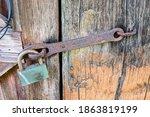 Old Metal Lock On A Rusty Hing...