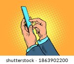 men hands with a smartphone.... | Shutterstock .eps vector #1863902200