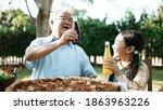 Happy Asian Grandchild Drinking ...