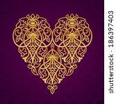 ornate gold heart on dark... | Shutterstock .eps vector #186397403