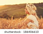 beautiful young woman sitting... | Shutterstock . vector #186406610