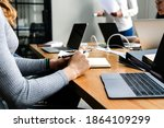 people using laptops in a... | Shutterstock . vector #1864109299